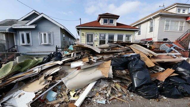 PHOTO: The contents of residents' once-flooded homes still lie in the streets of a neighborhood in the Rockaways section of New York on Christmas Day, Dec. 25, 2012, nearly two months after storm surge from Jamaica Bay during Superstorm Sandy flooded the 
