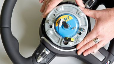 PHOTO: A worker demonstrates a wheel airbag initiator during a presentation for journalists at Takata Ignition Systems GmbH in Schoenebeck, Germany on April 17, 2014.