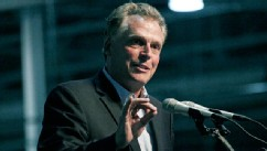 PHOTO: GreenTech Automotive chairman Terry McAuliffe speaks during the unveiling of GreenTech Automotive's new electric MyCar at their manufacturing facility in Horn Lake, Miss., July 6, 2012.