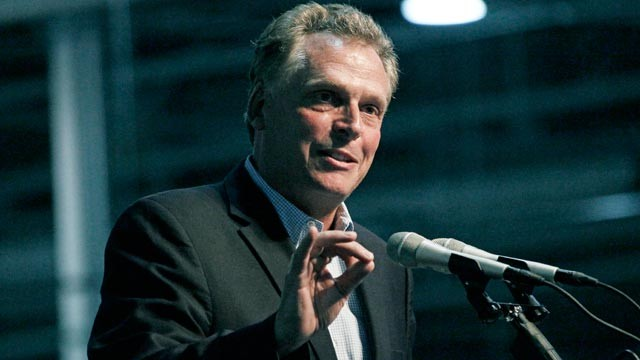 PHOTO: GreenTech Automotive chairman Terry McAuliffe speaks during the unveiling of GreenTech Automotives new electric MyCar at their manufacturing facility in Horn Lake, Miss., July 6, 2012.