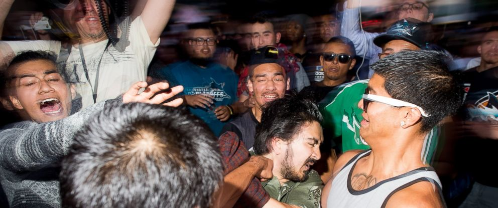 PHOTO: Protesters attack a man they mistakenly identified as a supporter of Republican presidential candidate Donald Trump outside a Trump campaign rally on Thursday, June 2, 2016, in San Jose, Calif.