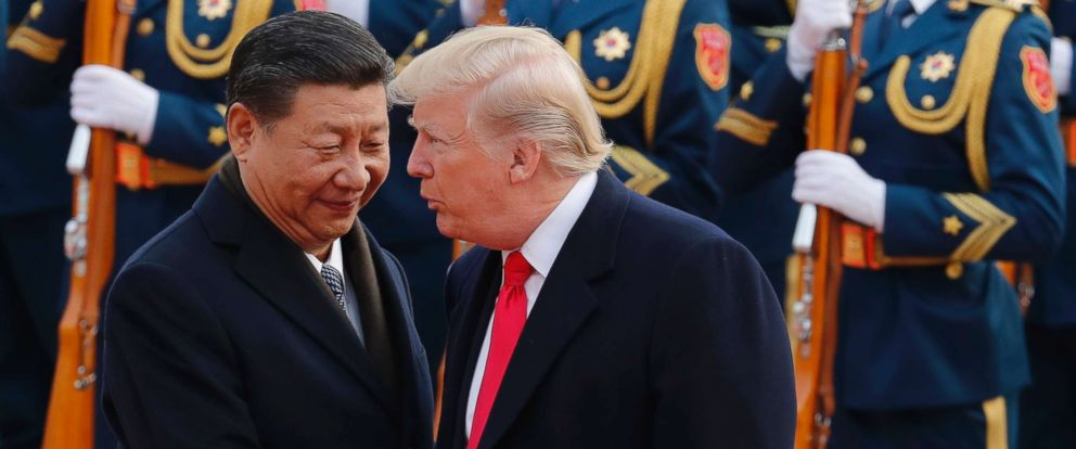 PHOTO: U.S. President Donald Trump, right, chats with Chinese President Xi Jinping during a welcome ceremony at the Great Hall of the People in Beijing, Thursday, Nov. 9, 2017.