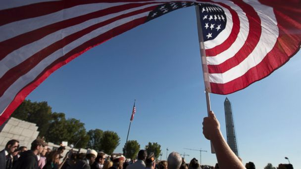 PHOTO: Marine Terri Shreiner holds an American flag during a rally at the National World War II Memorial, Tuesday, Oct. 15, 2013, in Washington, by the Military Coalition, to demand an end to the partial government shutdown.