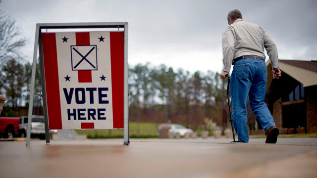PHOTO: A voter leaves a polling place in Birmingham, Ala. March 13, 2012.