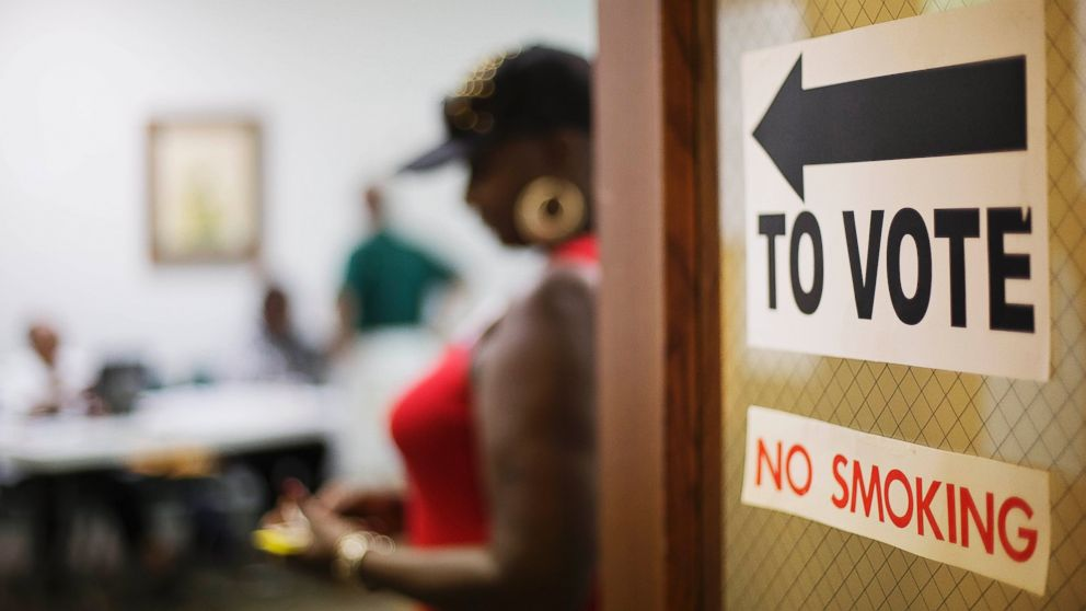 A sign directs voters at a polling site in Atlanta, Georgia, July 22, 2014.
