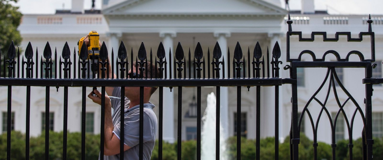 PHOTO: A workers installs metal spikes onto the existing White House fence in Washington, Wednesday, July 1, 2015.
