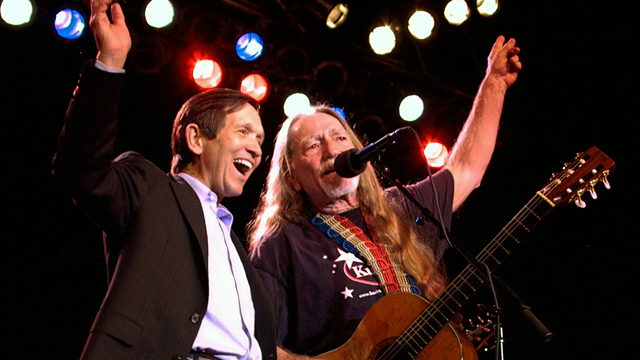 PHOTO: Dennis Kucinich, left, and musician Willie Nelson sing during a campaign fund-raising concert in Austin, Texas, in this Jan. 3, 2004, file photo.