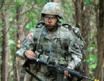 PHOTO: In a May 9, 2012 photo, Capt. Sara Rodriguez of the 101st Airborne Division walks through the woods during the expert field medical badge testing at Fort Campbell, Ky., May 9, 2012.