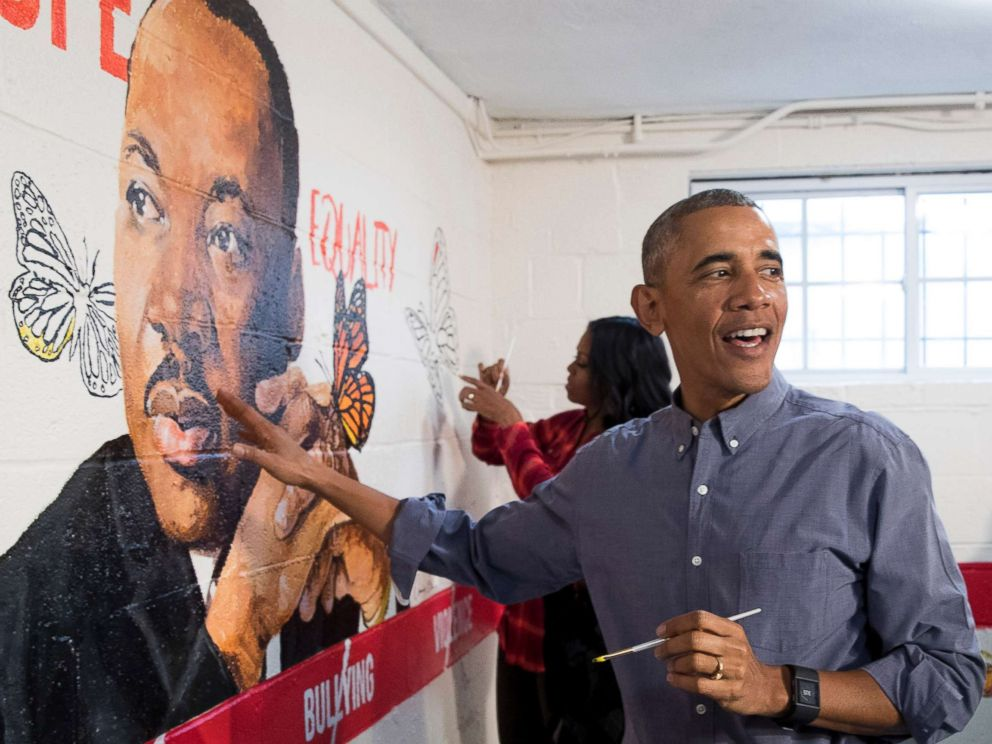 PHOTO: President Barack Obama and first lady Michelle Obama help paint a mural depicting Martin Luther King Jr., at the Jobs Have Priority Naylor Road Family Shelter, Jan. 16, 2017 in Washington.