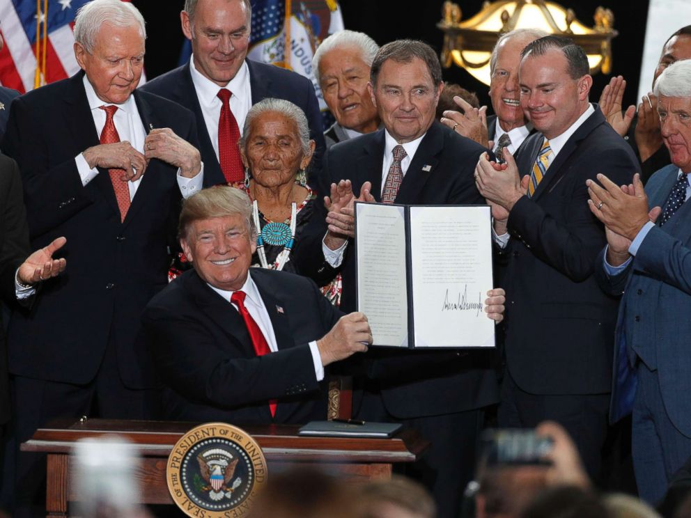 PHOTO: With Utah officials surrounding him, President Donald Trump shows an executive order he signed reducing the Grand Staircase-Escalante National Monument at the Rotunda of the Utah State Capitol, Dec. 4, 2017, in Salt Lake City, Utah.