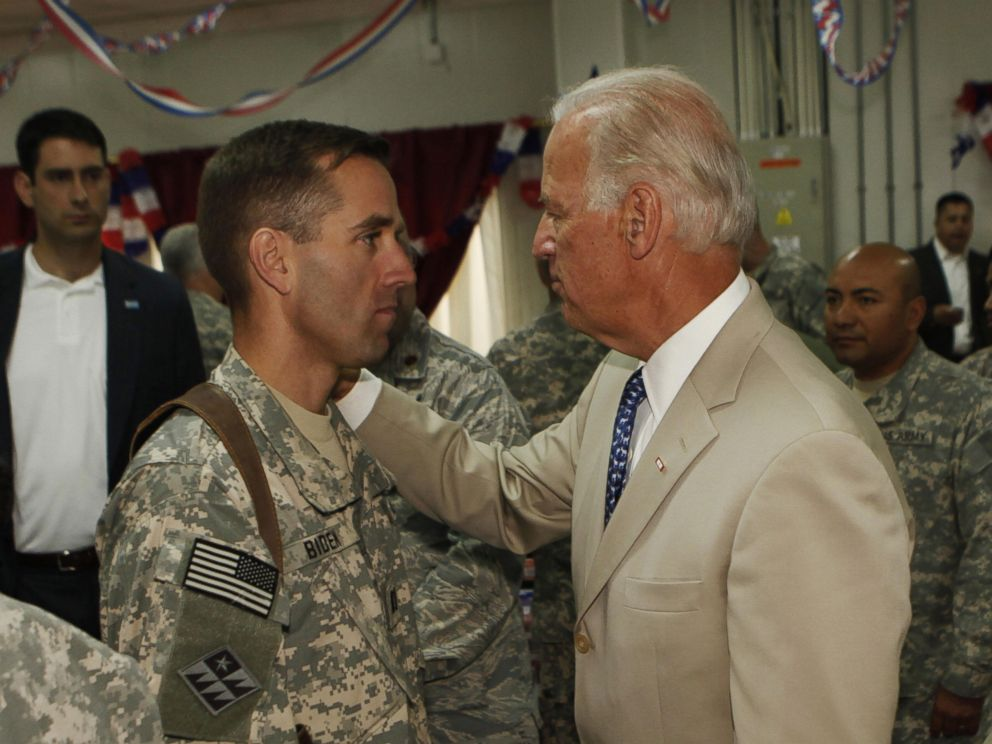 PHOTO: Vice President Joe Biden talks with his son, U.S. Army Capt. Beau Biden at Camp Victory on the outskirts of Baghdad on July 4, 2009.
