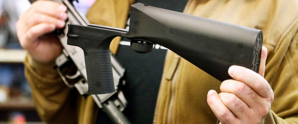 PHOTO: A bump stock device (right), that fits on a semi-automatic rifle to increase the firing speed, making it similar to a fully automatic rifle, is shown next to a AK-47 semi-automatic rifle at a gun store on Oct. 5, 2017, in Salt Lake City, Utah.
