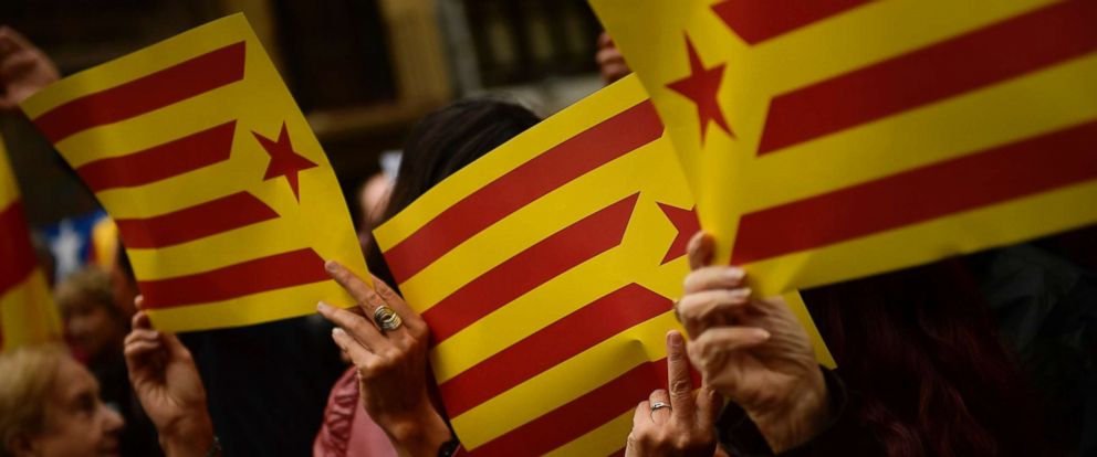 PHOTO: People display Catalonia independence flags during a gathering, Sept. 22, 2017, to protest the judicial and police operation against the planned October 1 independence referendum in Catalonia, Spain.