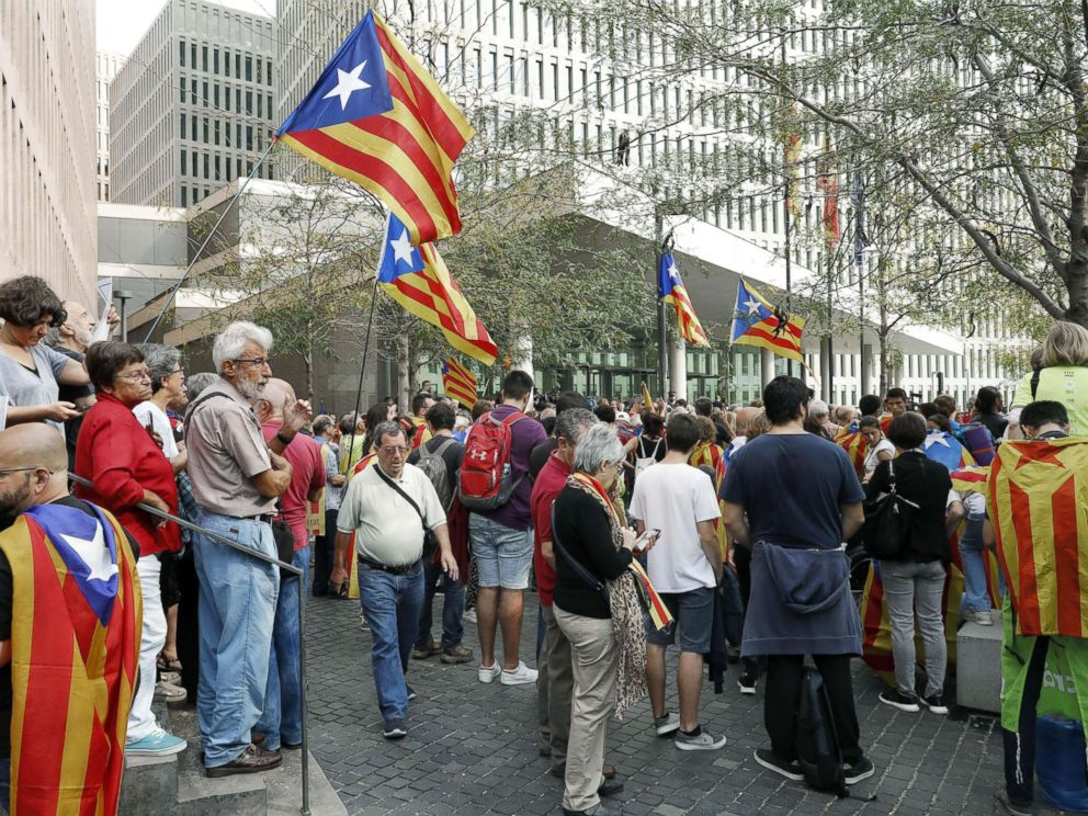 PHOTO: People wave unofficial Catalonian flags esteladas during a protest in front of the Superior Court of Justice in Barcelona, Spain, September 22,2017.