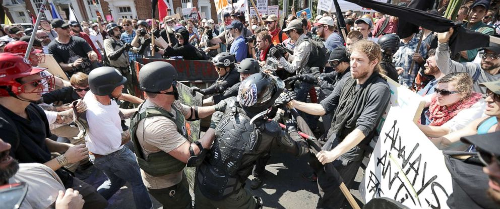 "PHOTO: White nationalists, neo-Nazis and members of the ""alt-right"" clash with counter-protesters as they enter Lee Park during the ""Unite the Right"" rally, Aug. 12, 2017, in Charlottesville, Va."