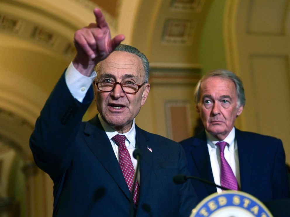 PHOTO: Senate Minority Leader Sen. Chuck Schumer of N.Y., standing with Sen. Edward Markey, D-Mass., speaks to reporters following the weekly Democratic policy luncheon on Capitol Hill in Washington, Oct. 31, 2017.