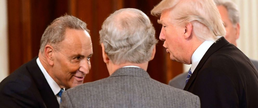 PHOTO: President Donald Trump speaks with Chuck Schumer at a reception for House and Senate Republican and Democratic leaders in the State Dining Room of the White House, Jan. 23, 2017 in Washington.