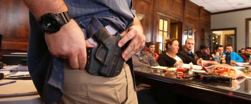 PHOTO: A man shows a holster at a concealed gun carry permit class on Dec. 19, 2015 in Provo, Utah.