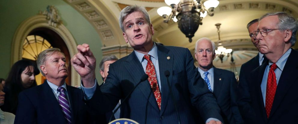 PHOTO: Sen. Bill Cassidy, R-La., center, speaks to the media, accompanied by Sen. John Cornyn, R-Texas, and Senate Majority Leader Mitch McConnell of Ky., on Capitol Hill, Sept. 19, 2017.