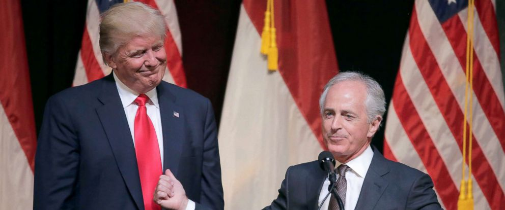 PHOTO: Republican U.S. presidential candidate Donald Trump listens as Senator Bob Corker speaks at a campaign rally in Raleigh, N.C. in this July 5, 2016 file photo.