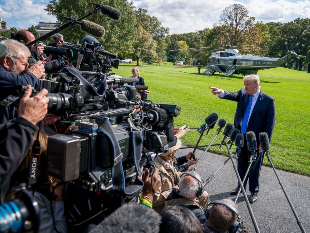 PHOTO: President Donald Trump calls on a reporter before boarding Marine One on the South Lawn of the White House in Washington, Oct. 25, 2017, for a short trip to Andrews Air Force Base, Md. and then on to Dallas.
