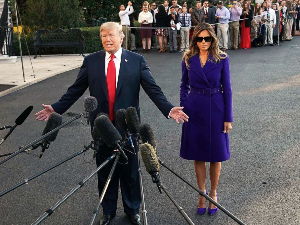 PHOTO: President Donald Trump and First Lady Melania Trump speak to the press as they make their way to board Marine One before departing from the South Lawn of the White House, Nov. 3, 2017.