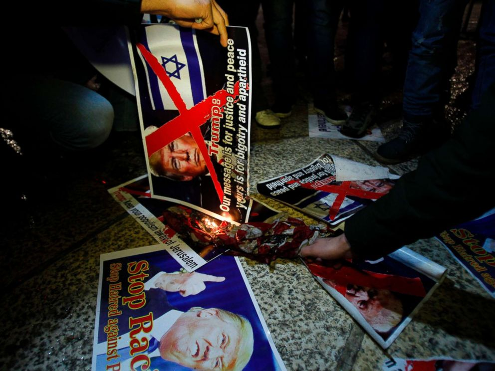 PHOTO: Demonstrators burn posters of President Trump in Bethlehems Manger Square in protest over Trumps declaration of Jerusalem as Israels capital on Dec. 6, 2017.