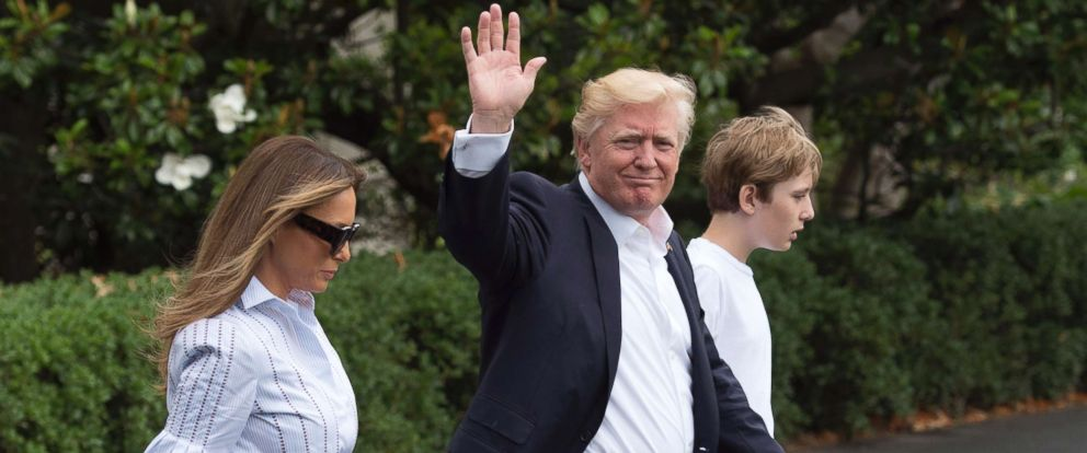 PHOTO: President Donald Trump boards Marine One with first lady Melania Trump and their son Barron Trump, as they depart the White House for Camp David, June 17, 2017 in Washington.