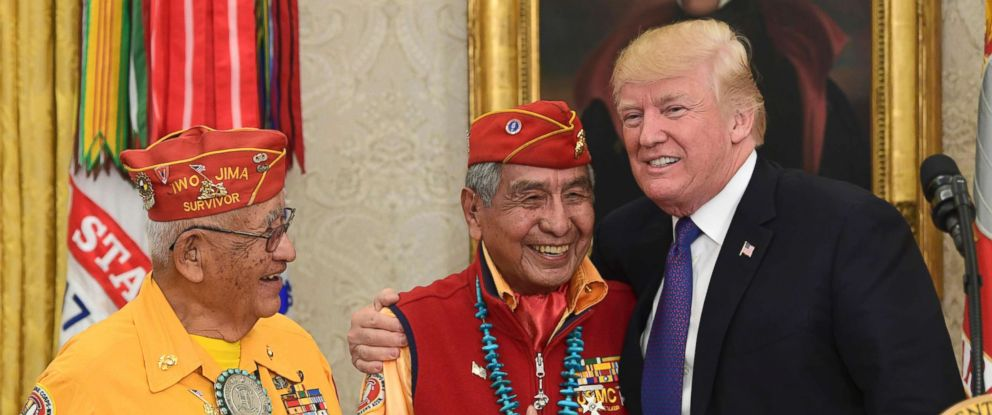 PHOTO: President Donald Trump, right, meets with Navajo Code Talkers Peter MacDonald, center, and Thomas Begay, left, in the Oval Office of the White House in Washington, D.C., Nov. 27, 2017.
