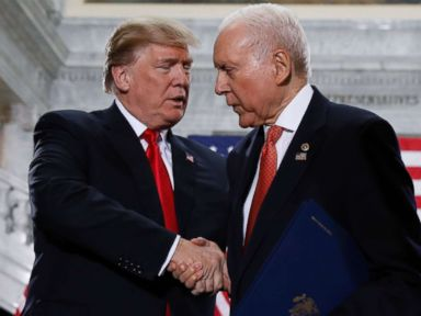 PHOTO: President Donald Trump is greeted by Sen. Orrin Hatch prior to speaking at the Utah State Capitol in Salt Lake City, Dec. 4, 2017.