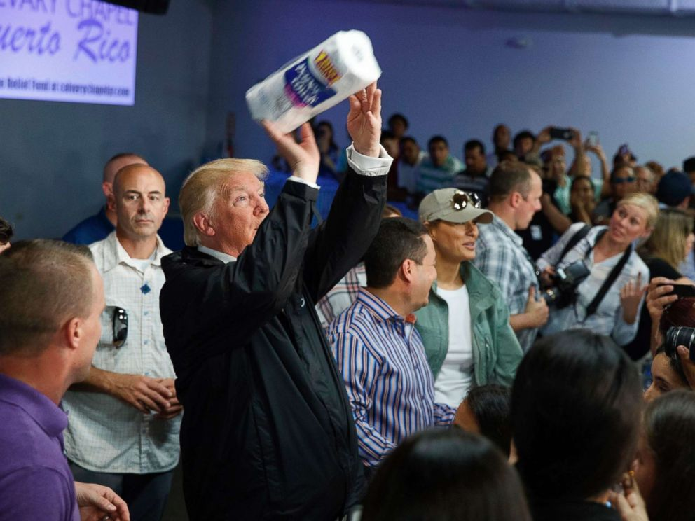 PHOTO: President Donald Trump tosses paper towels into a crowd as he hands out supplies at Calvary Chapel, Oct. 3, 2017, in Guaynabo, Puerto Rico.