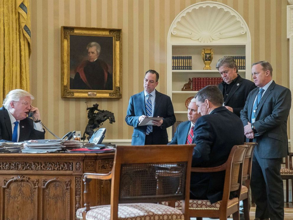 PHOTO: President Donald Trump, accompanied by Reince Priebus, Vice President Mike Pence, Michael Flynn, Steve Bannon, and Sean Spicer, speaks on the phone with Russian President Vladimir Putin at the White House, Jan. 28, 2017.
