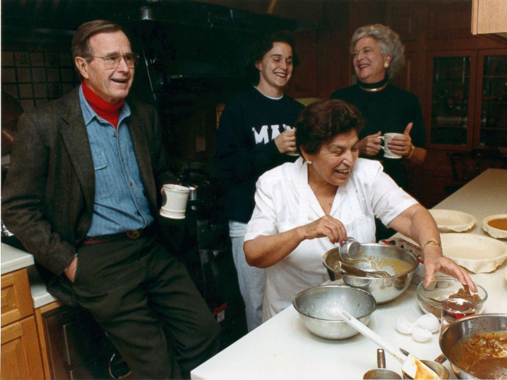 PHOTO: President George H.W. Bush shares drink with his daughter, Dorothy, and first lady Barbara Bush in the kitchen at Camp David, Maryland on Nov. 23, 1989 as Thanksgiving Dinner is being prepared.