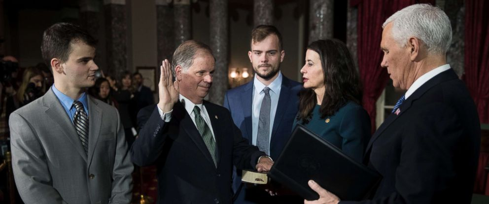 PHOTO: Democratic Senator Doug Jones (2-L), with his wife Louise Jones (2-R) and sons Christopher (L) and Carson Jones (C), is ceremonially sworn in by Vice President Mike Pence in the US Capitol, Jan. 3, 2018.