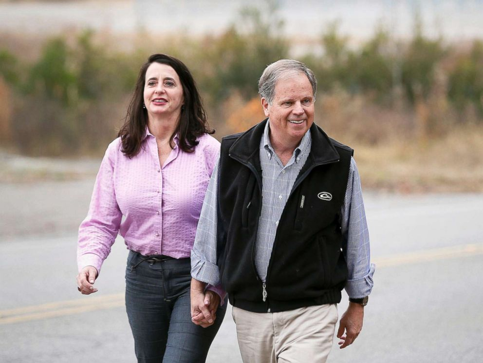 PHOTO: Democratic senatorial candidate Doug Jones, right, walks to a news conference with his wife, Louise Jones, Dec. 4, 2017, in Dolomite, Ala.