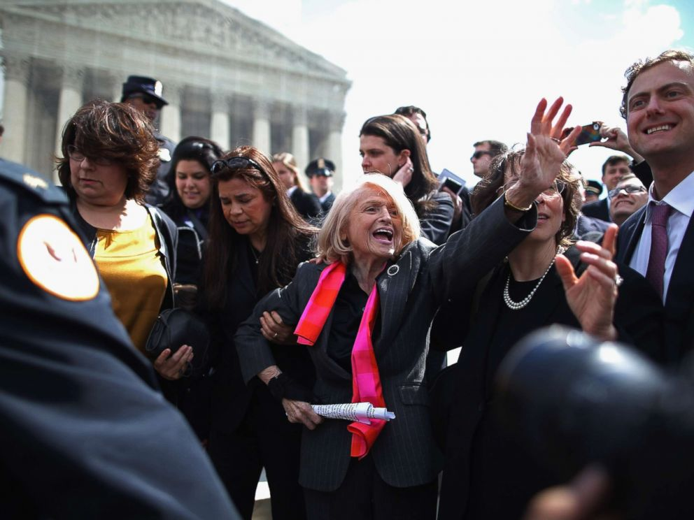 PHOTO: Edith Windsor, 83, is mobbed by journalists and supporters as she leaves the Supreme Court March 27, 2013 in Washington.