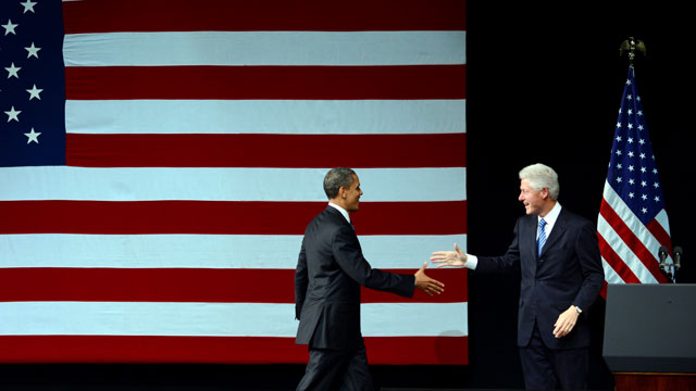 PHOTO: US President Barack Obama is introduced by former US President Bill Clinton during a fundraiser at the New Amsterdam Theater in New York, June 4, 2012.