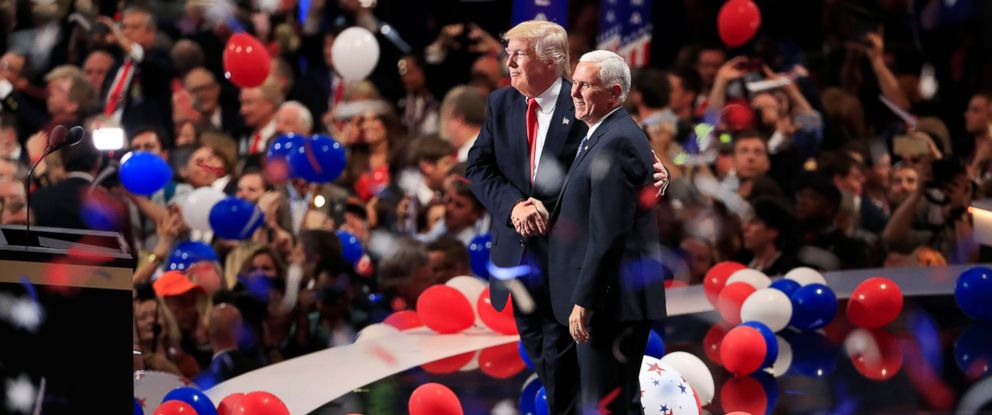 PHOTO: Republican presidential nominee Donald Trump and Vice Presidential nominee Mike Pence stand on the stage together as balloons drop on the final day of the 2016 Republican National Convention in Cleveland, July 21, 2016.
