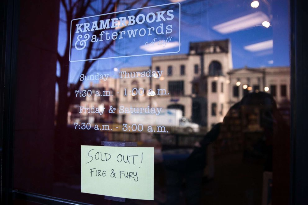 """PHOTO: A sign on the door of Kramerbooks and Afterwards warns customers that Michael Wolffs book """"Fire and Fury,"""" the tell all about the Trump White House, is sold out, Jan. 5, 2018, in Washington."""
