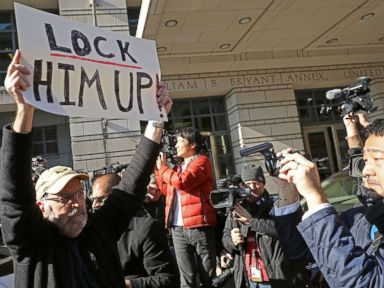 PHOTO: A handful of demonstrators held signs outside the Federal Courthouse where Michael Flynn, former national security adviser to President Donald Trump, had his plea hearing December 1, 2017 in Washington, DC.