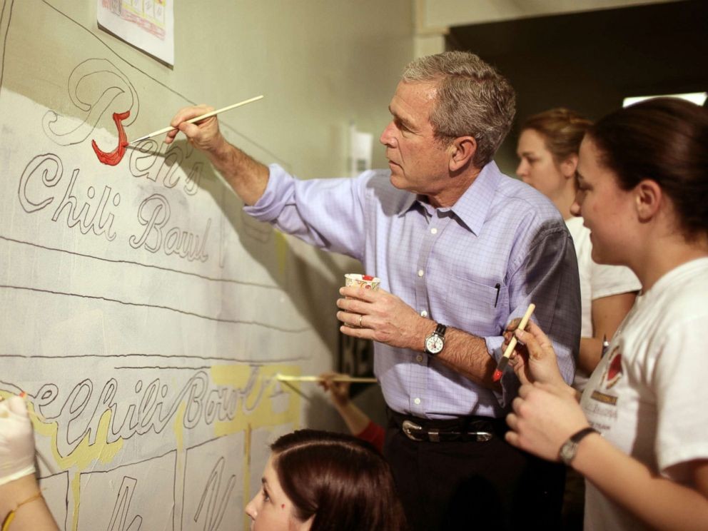 PHOTO: President George W. Bush helps volunteers paint a mural at a high school during the Martin Luther King Jr day of service in Washington, Jan. 15, 2007.