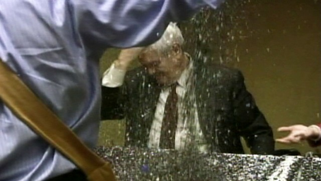 VIDEO: Gay rights activist pours glitter on Newt Gingrich at a book signing.
