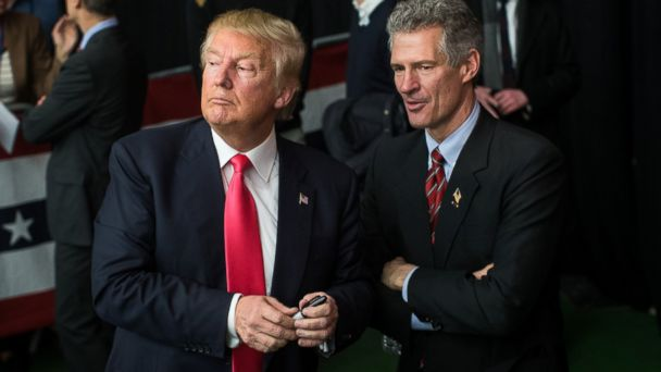 PHOTO: Former U.S. Senator Scott Brown talks with then presidential candidate Donald Trump after he endorsed Trump during a campaign rally in Milford, N.H., Feb. 2, 2016.