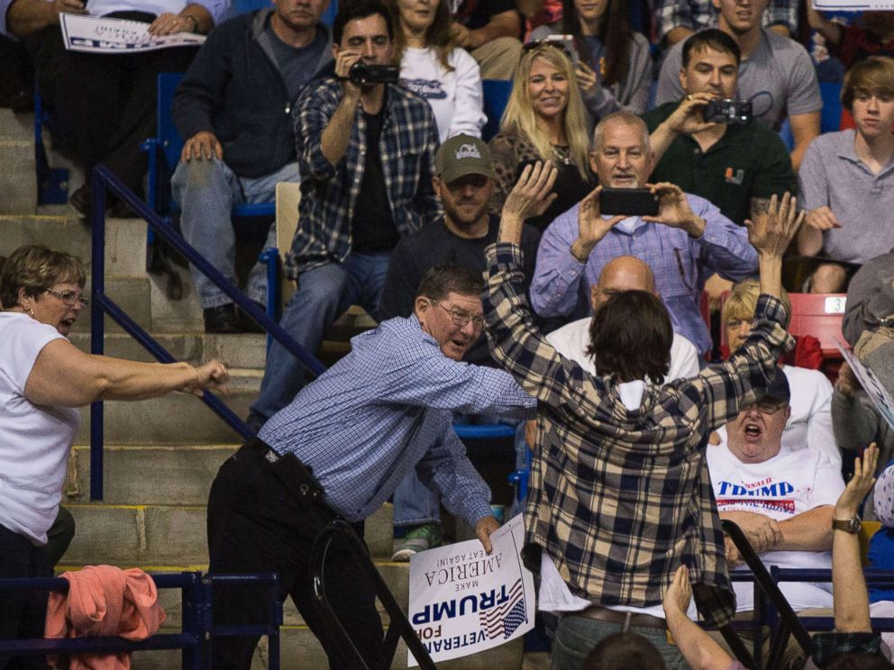 PHOTO: A demonstrator is thrown out as Republican presidential candidate Donald Trump speaks at a campaign rally at the Crown Center Coliseum in Fayetteville, N.C, March 9, 2016.