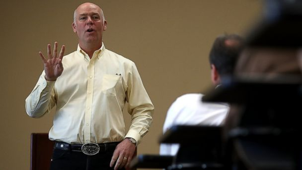PHOTO: Republican congressional candidate Greg Gianforte speaks to supporters during a campaign meet and greet at Lambros Real Estate on May 24, 2017 in Missoula, Mont.