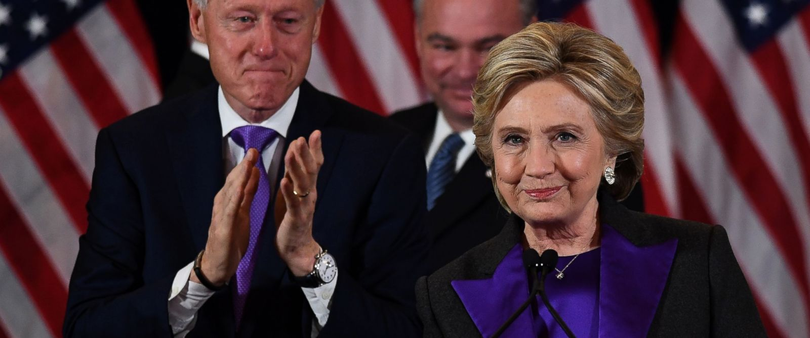 PHOTO: Presidential candidate Hillary Clinton makes a concession speech as former President Bill Clinton and running mate Tim Kaine look on in New York on Nov. 9, 2016.