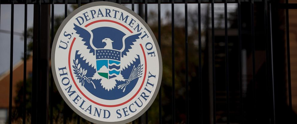 PHOTO: The U.S. Department of Homeland Security (DHS) seal hangs on a fence at the agencys headquarters in Washington, Dec. 11, 2014.