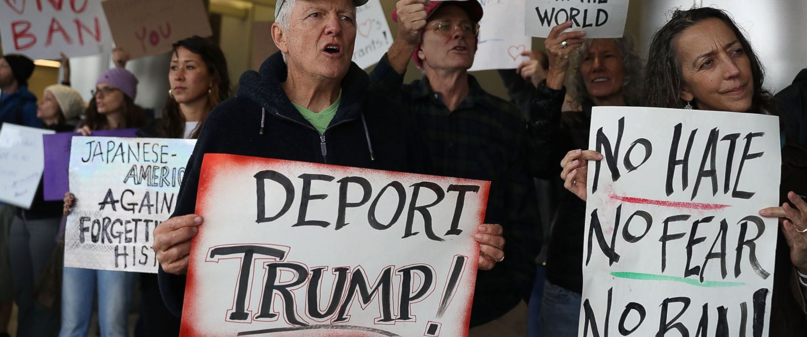 PHOTO: Protesters stand together at the Miami International Airport against the executive order that President Donald Trump signed restricting travelers from seven predominantly Muslim countries, Jan. 29, 2017 in Miami.
