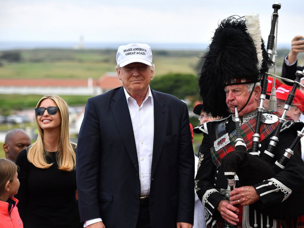 PHOTO: A bagpipe player wears traditional dress next to Donald Trump and his family as they arrive to his Trump Turnberry Resort, June 24, 2016, in Ayr, Scotland.