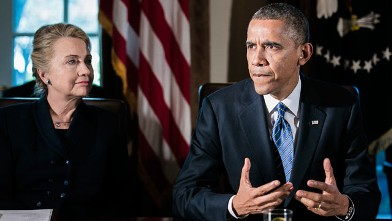 PHOTO: President Barack Obama, right, speaks as U.S. Secretary of State Hillary Clinton listens at a cabinet meeting at the White House, Nov. 28, 2012 in Washington, DC.